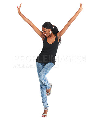 Buy stock photo Studio shot of a carefree young woman with her arms raised isolated on white