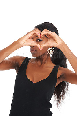 Buy stock photo Young woman making a heart shape with her fingers while isolated on white