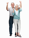 Senior couple with hands raised enjoying on white background