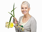 Happy old female gardener holding rake and young plant on white