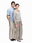 Full length portrait of a confident mature couple on white