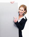 Happy business woman pointing at billboard