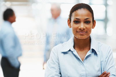 Buy stock photo Portrait of a confident African American business woman with colleagues in the background