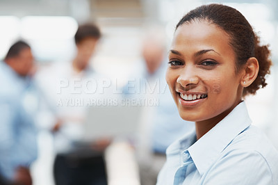 Buy stock photo Closeup of a pretty African American executive with colleagues in the background - copyspace