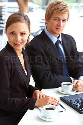 Buy stock photo Portrait of two young businesspeople working in a cafe