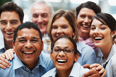 Buy stock photo Closeup portrait of a diverse team of successful businesspeople laughing together