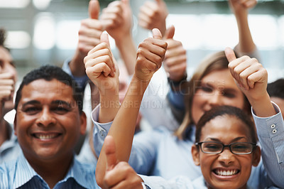 Buy stock photo Business approval - Closeup of multi ethnic colleagues with thumbs up sign