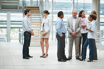 Buy stock photo Multi ethnic business people talking to each other during their office break