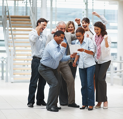 Buy stock photo Happy group of business people excited about the approval of a contract