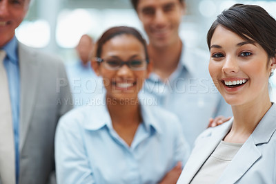 Buy stock photo Young successful business leader with her colleagues smiling