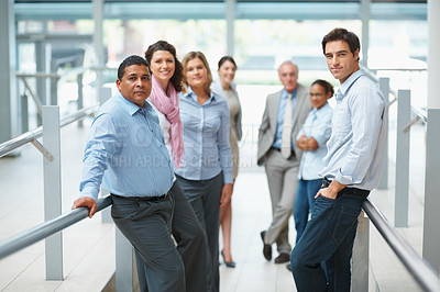 Buy stock photo Confident multi ethnic business group standing in a light and modern office
