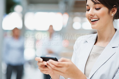 Buy stock photo Beautiful happy business woman reading a text message on blur background