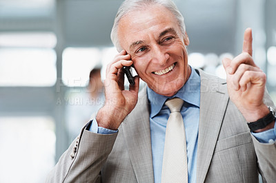 Buy stock photo Smiling successful senior business man speaking on the cellphone