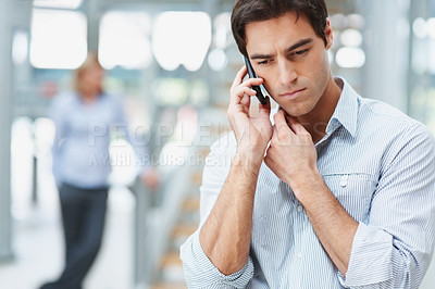 Buy stock photo Young Caucasian business man talking on the mobile phone