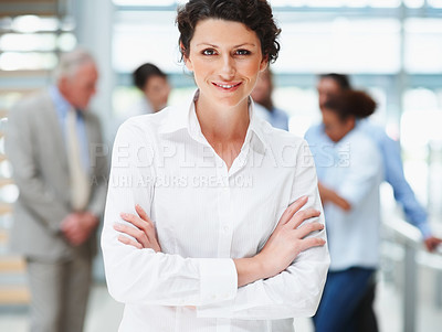 Buy stock photo Confident pretty business woman with her colleagues at the back