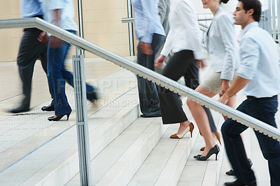 Buy stock photo Low section of busy business people ascending on office stairs