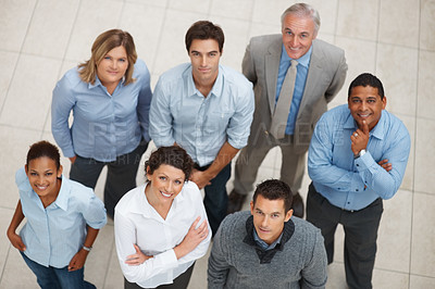 Buy stock photo Top view of a smiling group of business people standing together and looking up