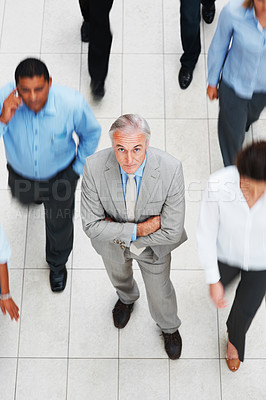Buy stock photo Top view of successful business man with colleagues walking besides him