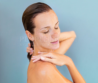 Buy stock photo Beautiful young woman looking relaxed and serene while feeling her skin after a shower