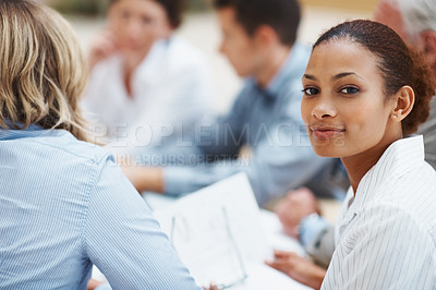 Buy stock photo Portrait of a beautiful African American business woman in meeting with colleagues