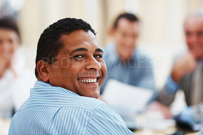 Buy stock photo Happy mature mixed race business man with colleagues in a meeting