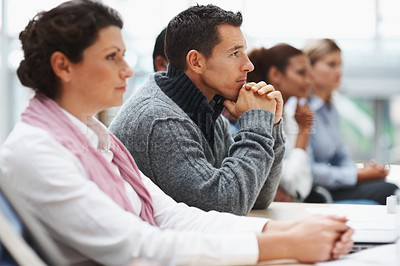 Buy stock photo Serious business men and women attending a seminar - paying attention