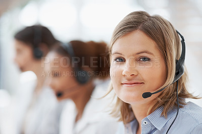 Buy stock photo Closeup portrait of a pretty call centre employee smiling at you while wearing her headset - copyspace