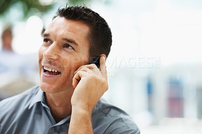 Buy stock photo Young business man talking over the cellphone and looking away