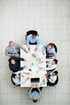 Buy stock photo Top view of business people sitting at a table for a meeting and looking upwards