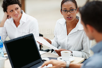 Buy stock photo Young African American woman putting up her point of view at a business meeting