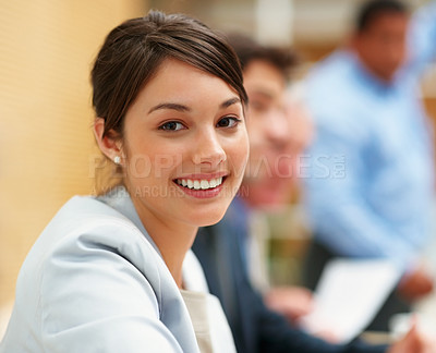 Buy stock photo Portrait of a cute business woman smiling with people at the back