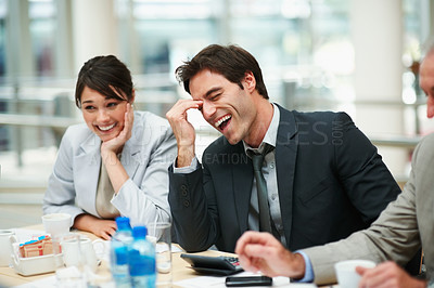 Buy stock photo Business executive enjoying a laugh during a boardroom meeting