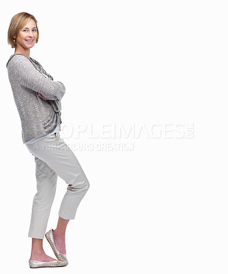 Buy stock photo Full length portrait of happy mature lady standing with hands folded against white background