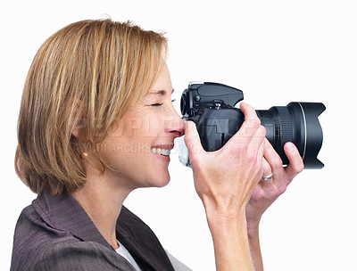 Buy stock photo Profile portrait of mature lady photographing with camera isolated over white background
