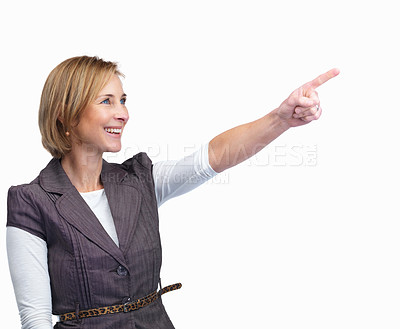 Buy stock photo Portrait of pretty mature lady pointing at something interesting isolated over white background