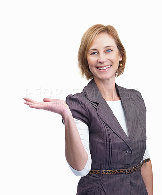Buy stock photo Portrait of beautiful mature woman showing your product isolated over white background