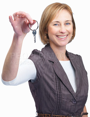 Buy stock photo Portrait of happy mature woman showing key to success isolated over white background