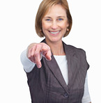 Happy mature female pointing at you over white background