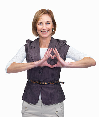 Buy stock photo Portrait of mature woman showing heart symbol isolated over white background