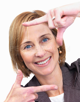 Buy stock photo Portrait of mature lady woman making a frame shape with her hands over white background