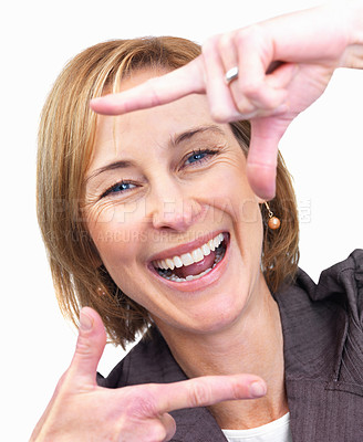 Buy stock photo Portrait of cheerful mature female making a frame with her hands isolated over white background