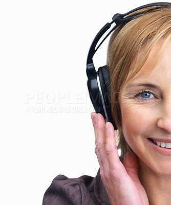 Buy stock photo Cropped image portrait of mature female listening to music isolated over white background