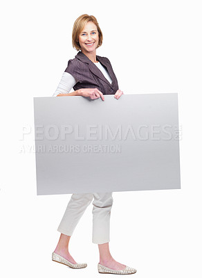 Buy stock photo Full length portrait of pretty mature woman holding a blank board isolated over white background