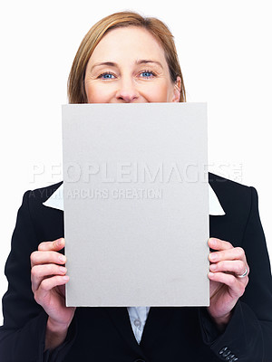 Buy stock photo Portrait of pretty  mature businesswoman peeping over blank billboard isolated over white background