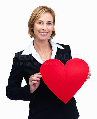 Buy stock photo Portrait of an attractive middle aged businesswoman holding a red heart over white background
