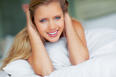 Buy stock photo Cute young woman giving you a warm smile on bed at home