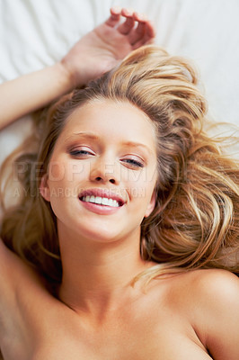 Buy stock photo Top view of a pretty happy young woman lying on bed