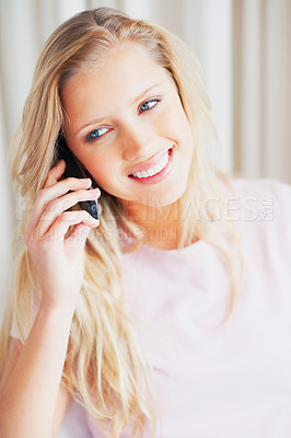 Buy stock photo Portrait of a beautiful smiling woman talking on a cell phone