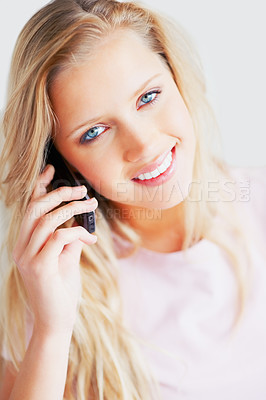 Buy stock photo Portrait of a smiling young woman using cell phone