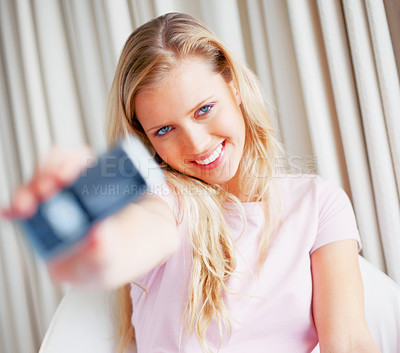 Buy stock photo Happy beautiful Caucasian woman holding out her new cell phone - focus on girl